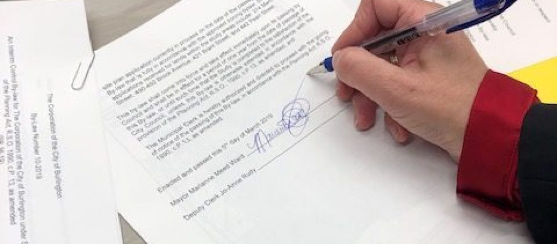 Burlington Mayor Marianne Meed Ward signs Interim Control Bylaw after Council's approval on Tuesday, March 5, 2019.